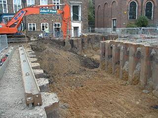 basement excavation underway inside sheet pile cofferdam
